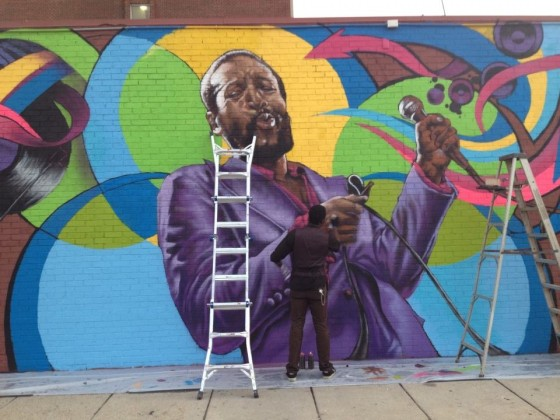 Aniekan Udofia putting the finishing touches on the Marvin Gaye mural on S Street, NW in 2014