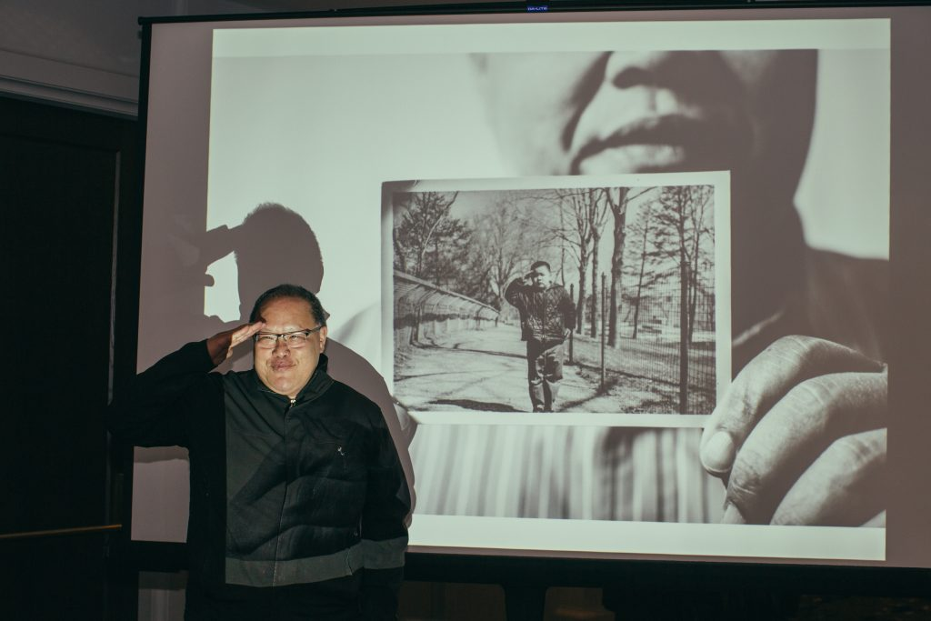 """14f74dff49 Tom Fong in front of a projection of his photo by Darrow Montgomery (age 8)  from the WCP article. Photo credit Mariah Miranda for The LINE DC """" ..."""